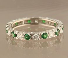 White gold, 14 kt, full eternity ring set with brilliant cut tsavorite and diamond, ring size 18.5 (58)