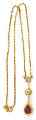 18 kt gold choker with pendant  1.37 ct ruby. Two brilliant cut diamonds of 1.08 ct and 0.70 ct (IGE certificate)