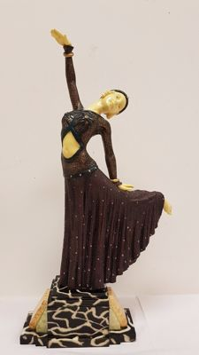 Statue of a dancing lady in Art Deco style.