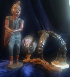 Traditional  African tribal statue , a face ,  a elephant and a egg
