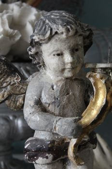 Antique hard-carved antique candlestick bearing angel/putto - Italy - 18th century