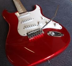 London City Spitfire MKIII, stratocaster model in colour candy apple red new generation