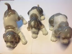 Lladró, three porcelain puppies