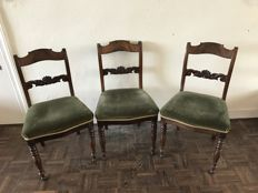 Three mahogany chairs with green fabric seating, late 19th century,