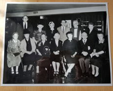 Vintage photographic print showing 13 Titanic survivors gathered together for a promotional campaign for the Titanic movie A Night To Remember.