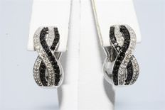 "14 kt gold twisted earrings with diamonds , 0.85 ct. ""No reserve price""."