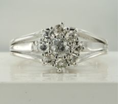 Platinum entourage ring with a central 0.28 ct Bolshevik cut diamond and an entourage of eight Bolshevik cut diamonds of 0.32 ct, ring size: 16.5 (52)