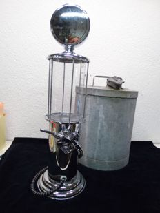 Drink dispenser in the shape of an old petrol pump plus a zinc petrol barrel