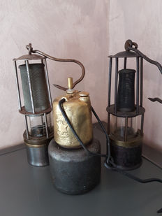 Three miner's lamps, from various countries from the 1930s to 1960