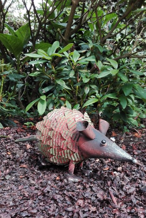A decorative iron sculpture of a possum
