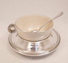 Rare, large porcelain cup for hot cocoa, with matching spoon and saucer in sterling silver 950/1000, hallmarks: Minerva's head 1st grade and Master Silversmith EP (for Emile Puiforcat).