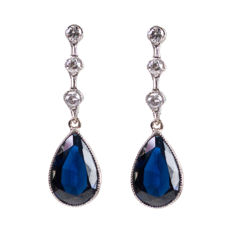 Platinum earrings set with Diamonds and pear cut Sapphires, design era: Art Deco (1915-1935)