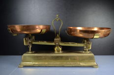 Brass scale with copper signs