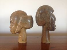 Heavy sculptures, African heads in marble.