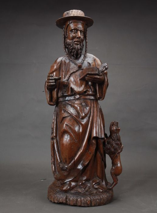 A large and rare carved walnut sculpture of Hieronymus and the lion - Southern Netherlands / France - 16th century