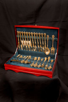 Gold covered  forks and spoons