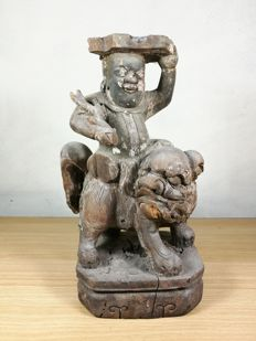 A Wooden sculpture Immortal riding a Lion - China - 17th/18th century