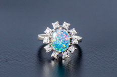 585 white gold ring with central opal and 10 diamonds (brilliant cut) approx. 0.15ct - size: 51.5