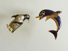 Two vintage brooches - dolphin and small penguin.
