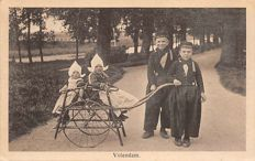 Volendam costumes 125 x with very old and also lesser known postcards.