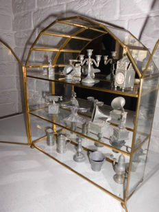 Decorative brass display case with mirror, a lovely design, with a collection of tin typecase figures, stylish cabinet!