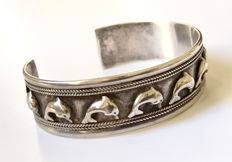 Solid silver bangle with dolphins
