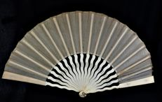 A large bridal folding fan - carved bone and organza - Spain - late 19th/early 20th century