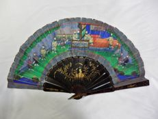 A one thousand faces folding hand fan - black lacquered and parcel gilt wood and hand painted paper - China - early 19th century