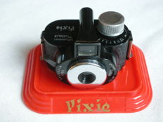 PIXIE, miniature camera in red display, 1950