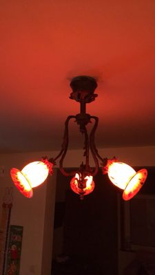 Beautiful antique chandelier in bronze and glass paste