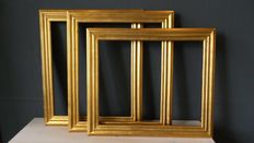 Three gold-plated picture frames - England - 20th century.