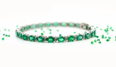 Fine 18 kt gold tennis bracelet with emeralds and brilliant cut diamonds totalling 9.50 ct - No reserve
