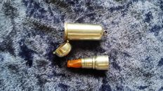 Solid silver tipped and amber cigarillo holder with solid silver case.