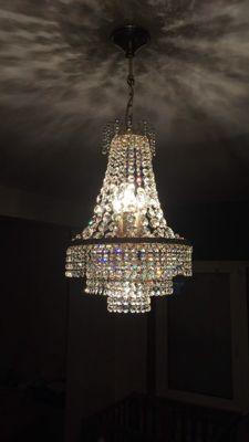 Beautiful antique crystal chandelier from 1980-1990 period with a silver gilt frame.