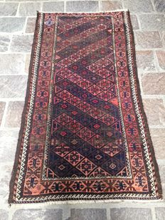 Hand knotted antique Belucistan carpet.