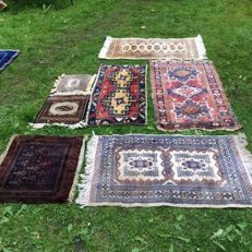 Several hand-knotted carpets with a small free carpet.