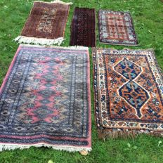Four hand-knotted carpets with an additional free carpet
