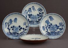 Collection of four dishes with decoration of weeping willows and blossoms - China - 18th century.