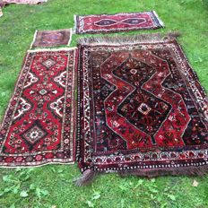 Four hand-knotted carpets