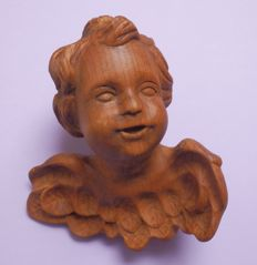 Carved putto in wood