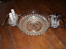 A beautiful salad bowl with salt and pepper, oil and vinegar set