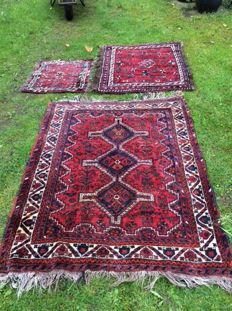Two hand-knotted carpets, with an additional, free carpet.