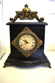 Antique wood fireplace/table clock decorated with inset gold decor, very fine