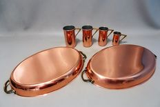 Four red copper measuring cups and two red copper fish kettles