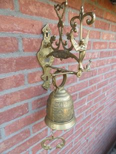Heavy and large monastery bell with angel