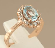 14 kt rose gold rosette ring with a blue topaz and 14 single cut diamond; ring size 16.5 (52)