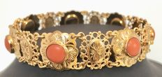 Gold boat bracelet with precious coral; lovely tooling all around. Precious corals are in perfect condition.