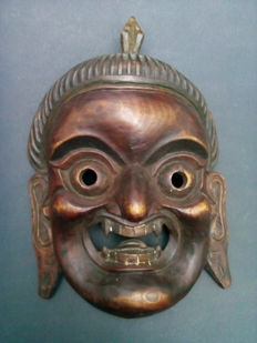 Hand carved wooden Himalayan mask - second half 20th Century