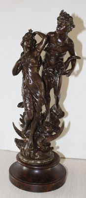 Zamac statue of Adam and Eve on a wooden base, 20th century