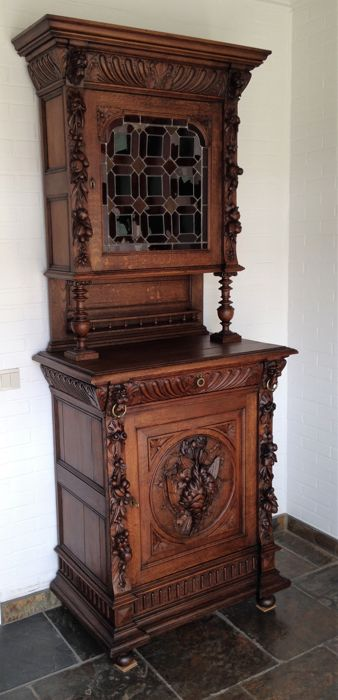 A carved walnut hunting furniture from Mechelen -ca. 1890